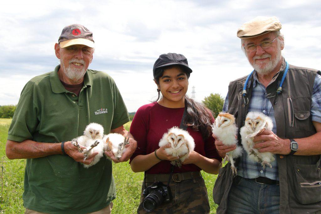 Howard Tannavi and Neil holding 5 Barn Owl chicks